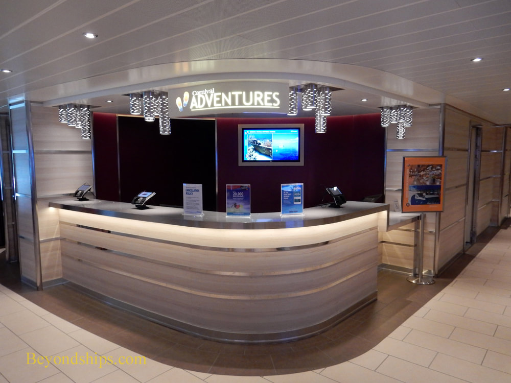 Shore excursions desk on on cruise ship Carnival Horizon