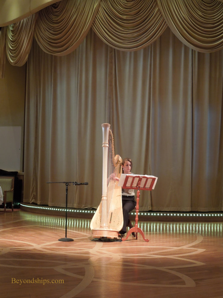 Harpist in Cruise ship Queen Victoria Queens Room