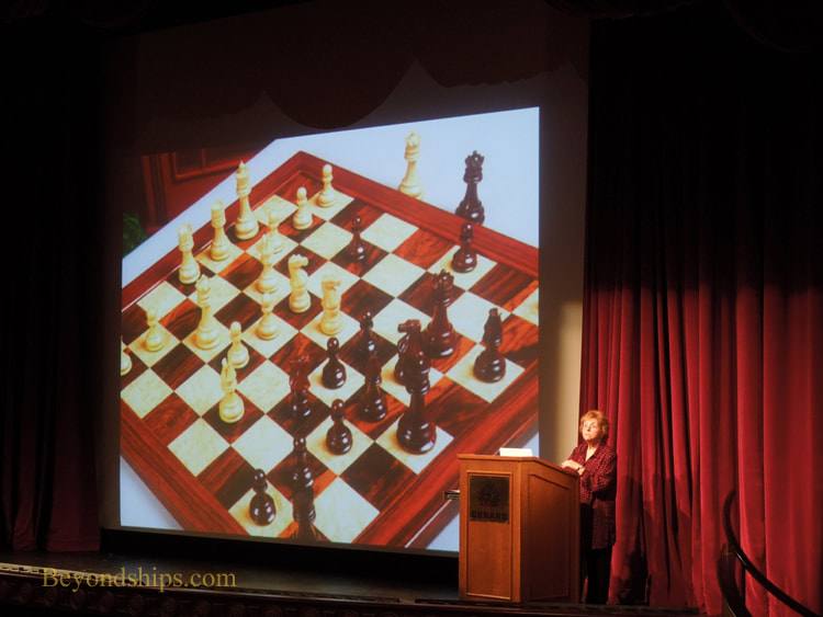 Diane Simpson lecturing in Cruise ship Queen Victoria Royal Court Theatre